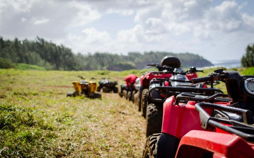 Line of ATVs parked along a trail in Northwest Ontario.