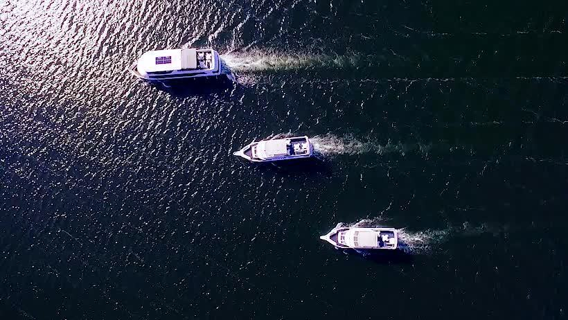 Aerial view of three boats on Mississippi waterways.